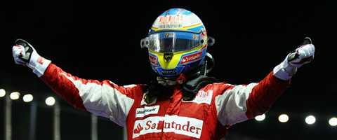 Fernando Alonso fick segern i Tyskland efter stallorder.