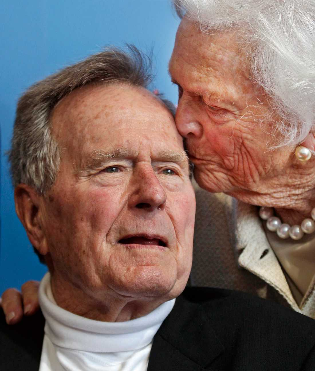 In this June 12, 2012 file photo, former President George H.W. Bush, and his wife, former first lady Barbara Bush, arrive for the premiere of HBO's new documentary on his life near the family compound in Kennebunkport, Maine.
