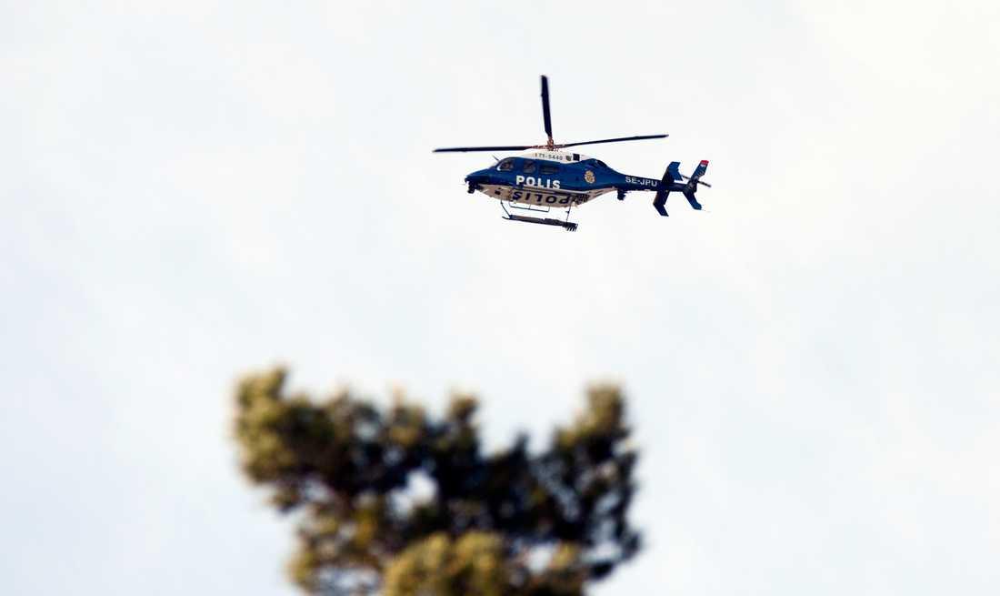 Polisen har kallat en helikopter till Märsta efter att en kvinna hittats död nära en skola.