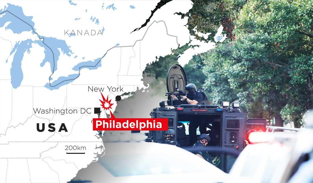 Polisens specialinsatsstyrka är på plats utanför en byggnad där skottlossning skett.