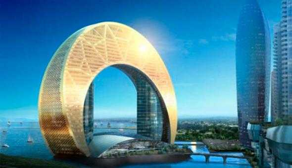 """Baku Hotel - planerad spektakulära byggnad Den bågformade exteriören bärs i själva verket upp av två """"normala"""" byggnader delvis gömda inne i den gyllene fasaden."""