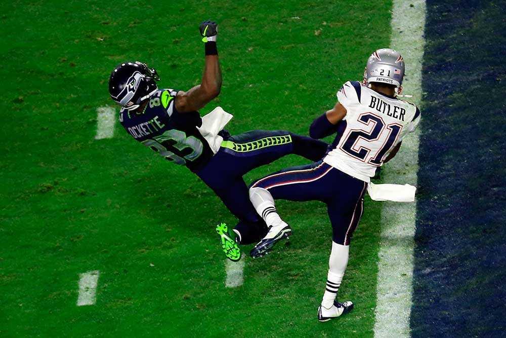 New England Patriots Butler gjorde en interception med bara 20 sekunder kvar av matchen och säkrade segern.