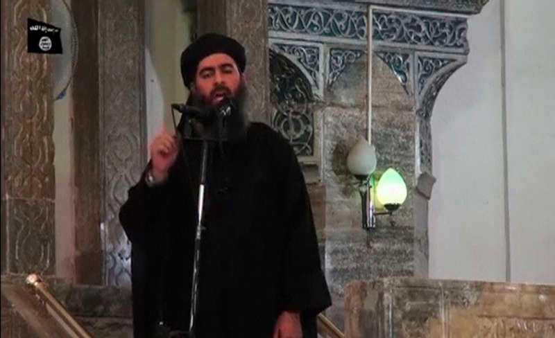 """IS ledare Abu Bakr al Baghdadi låter sig sällan fångas på bild, men här syns han på en video där han manar till """"helig kamp""""."""