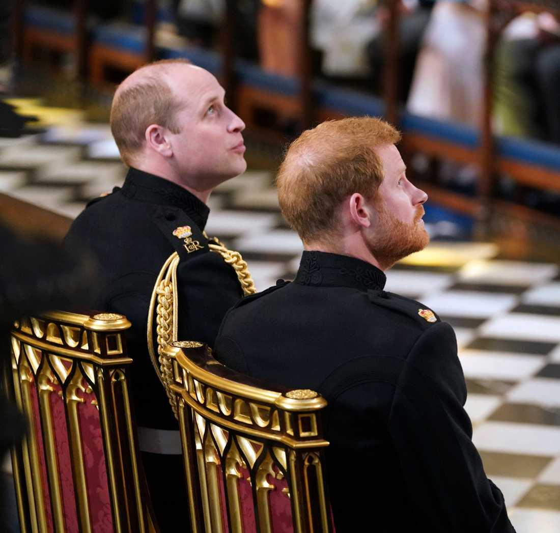 Prins William och prins Harry i Windsor castle vid bröllopet mellan Harry och Meghan 2018.