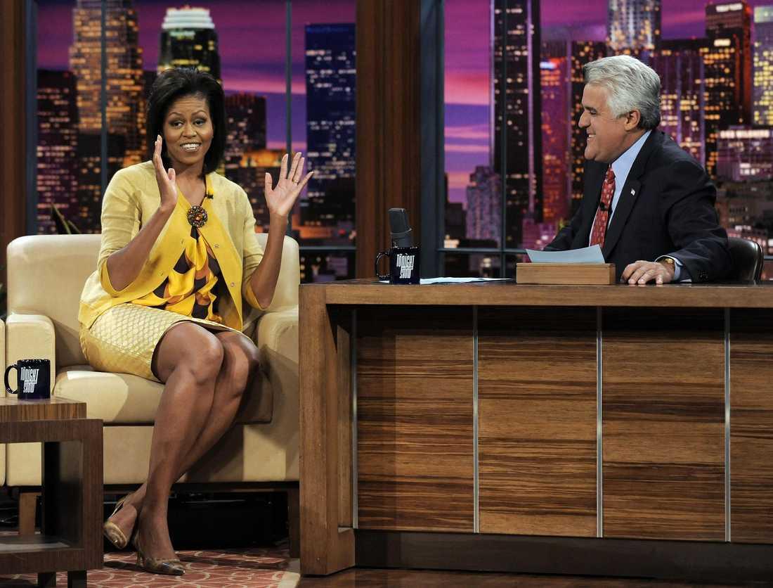Amerikanska klädkedjan J Crews aktier steg med 25 procent efter att Michelle Obama haft den här outfiten på sig i tv.