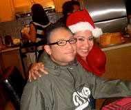 Eric och hans syster, före detta CNN-ankaret Veronica De La Cruz.
