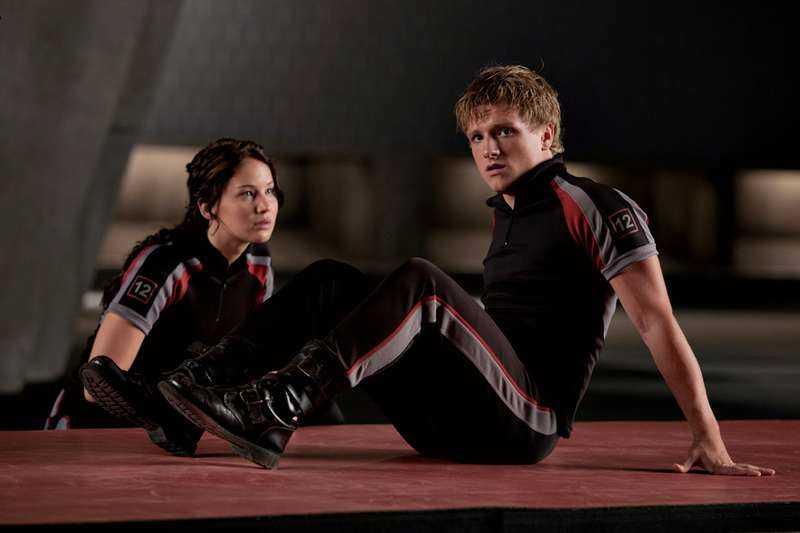 "Katniss och Peeta (Josh Hutcherson) i ""The hunger games""."