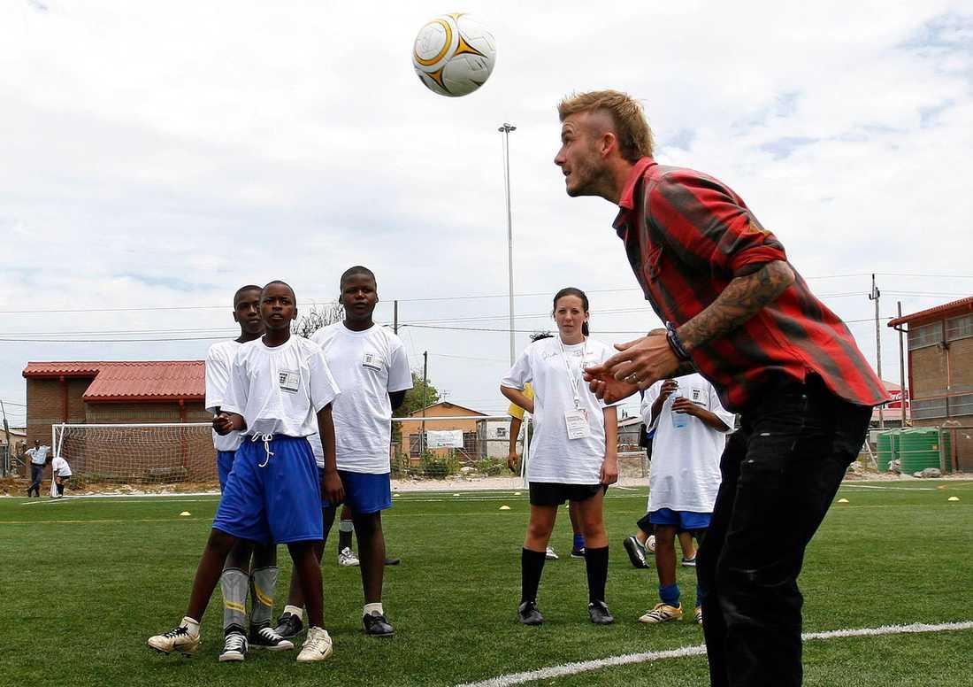 Beckham i Sydafrika i december 2009, ett halvår innan fotbolls-VM.