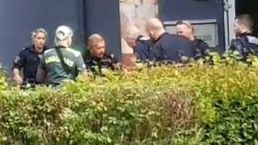 En man har skjutits av polis efter att ha gått till knivattack mot polisen.