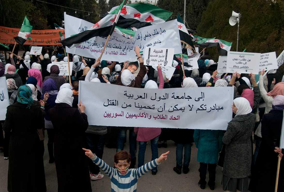 Protester mot regimen  i Homs 2011.