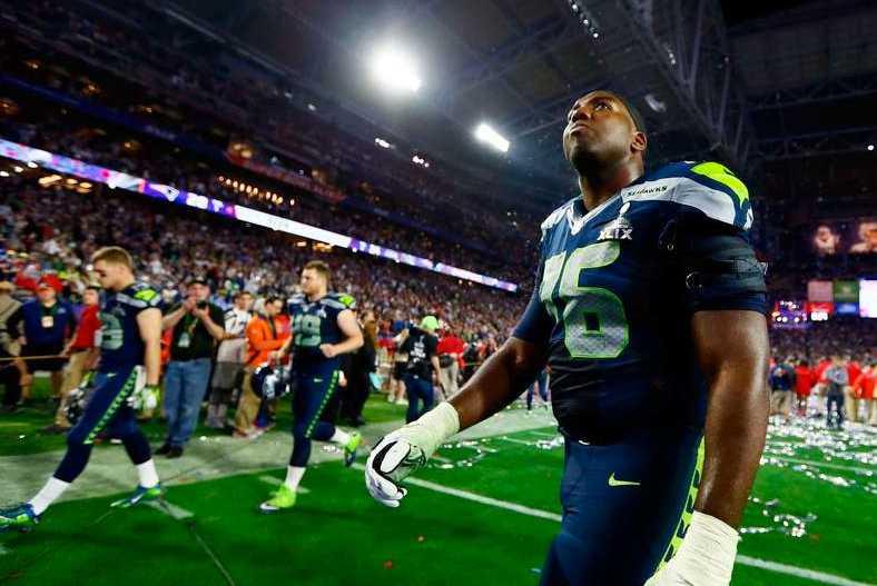 Okungligt Russel Okung, Seattle, får titta på när New England firar.