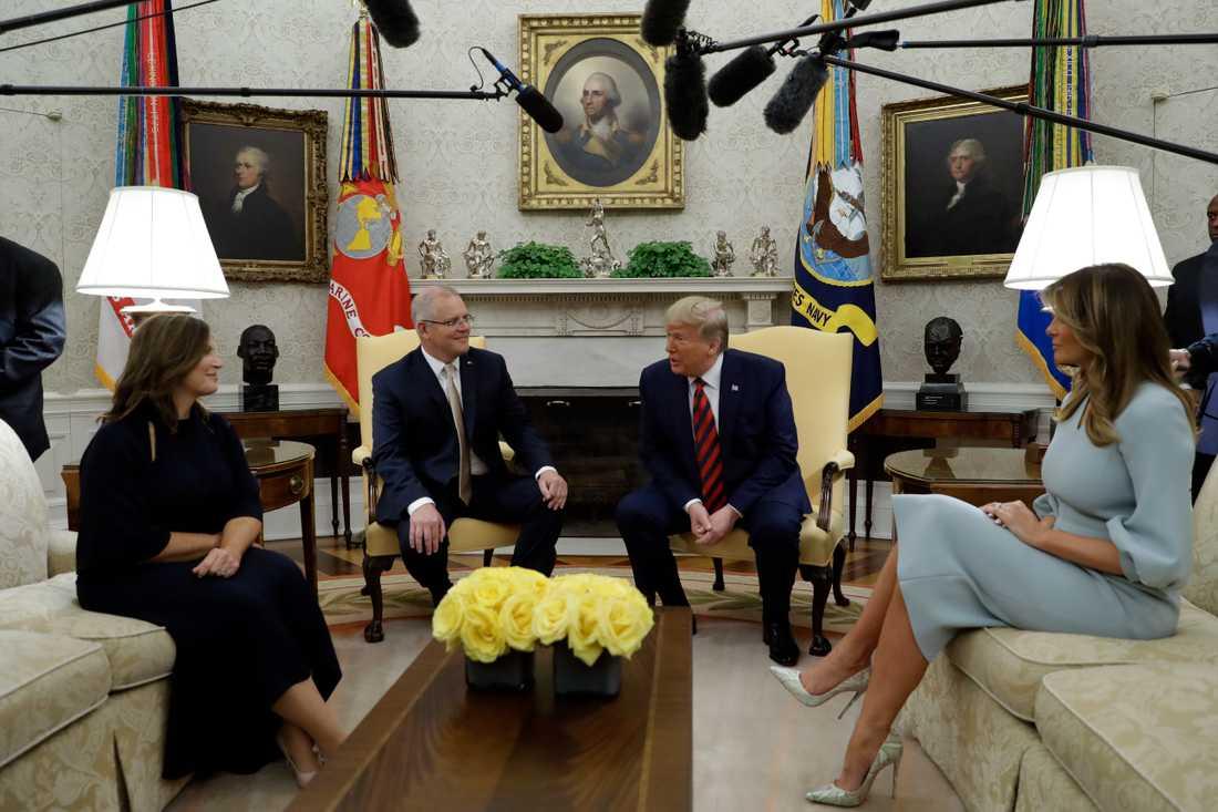 Scott Morrison och Donald Trump flankerade av sina fruar Jenny Morrison och Melania Trump i Vita huset i fredags.