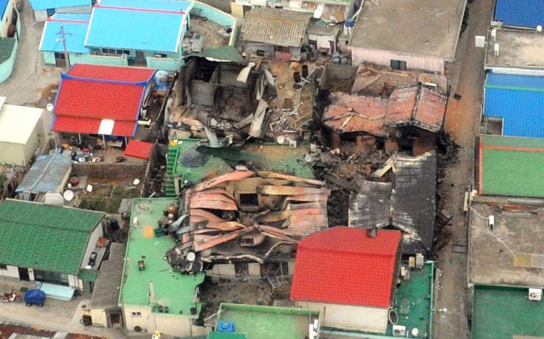 Förstörda hus på ön Yeonpyeong efter det nordkoreanska anfallet.