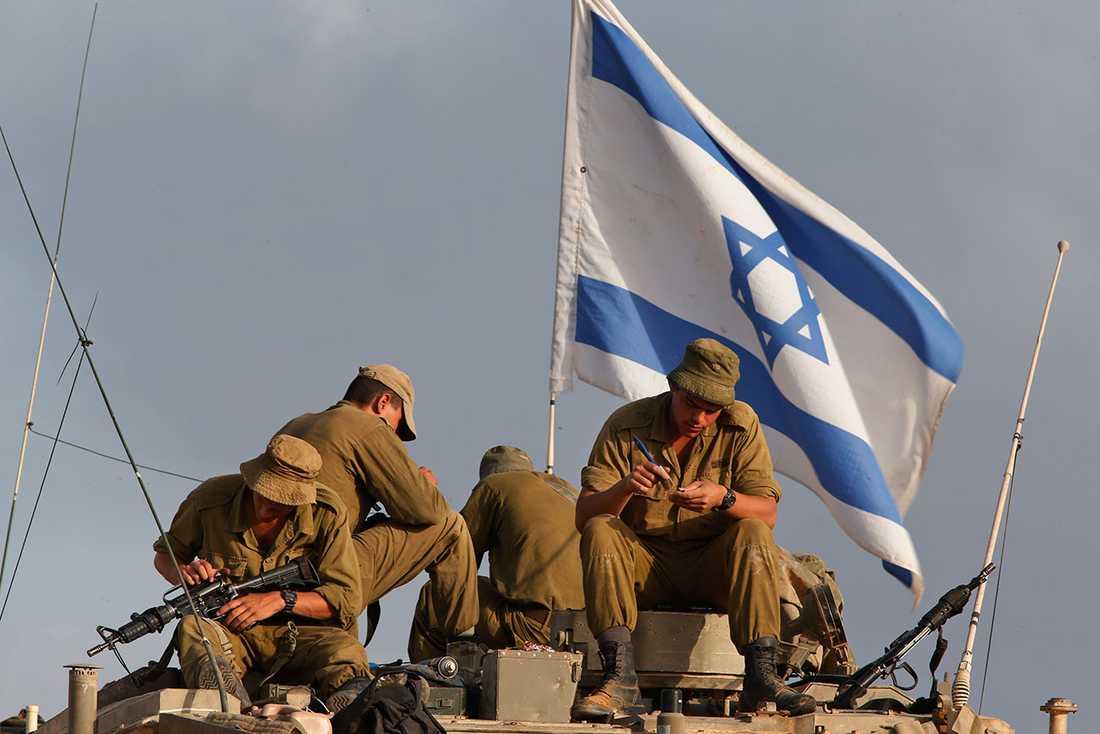 Israeliska soldater vid gränsen till Gaza under konflikten sommaren 2014.