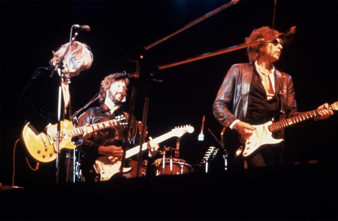 Tom Petty, Eric Clapton och Bob Dylan spelar på musikfestivalem Isle of Wight, 1969