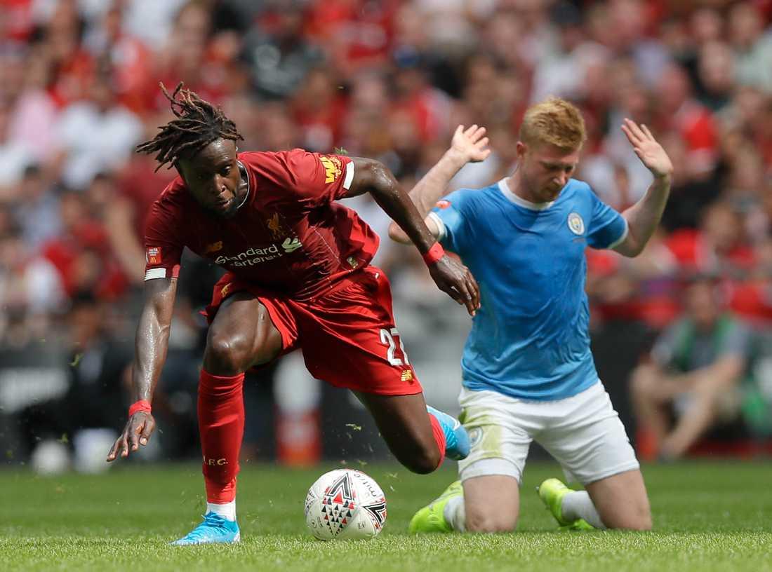 Liverpools Divock Origi och Manchester Citys Kevin De Bruyne.