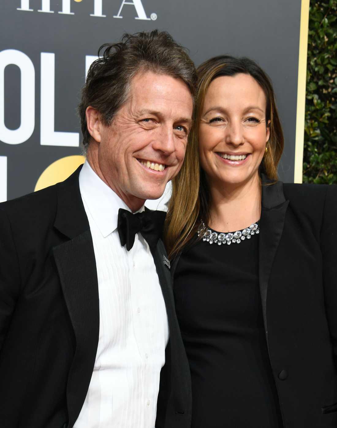 Hugh Grant och Anna Eberstein under Golden Globe i år.