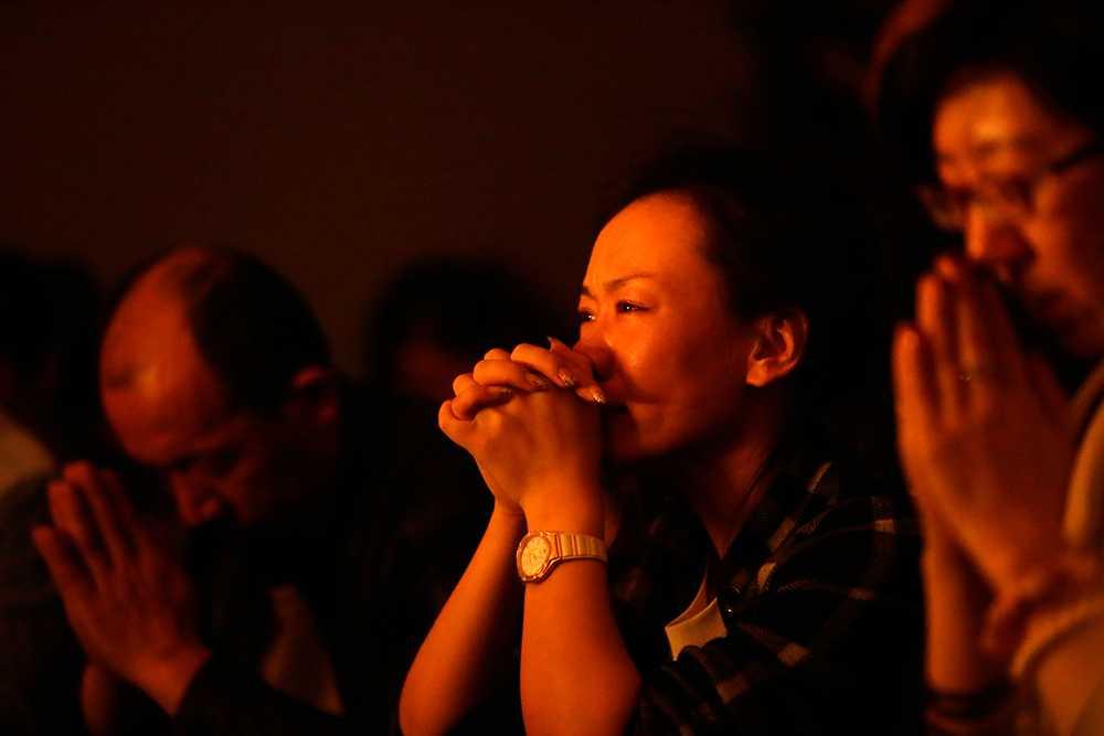 Anhöriga till passagerare på försvunna planet MH370 på ett hotell i Beijing.