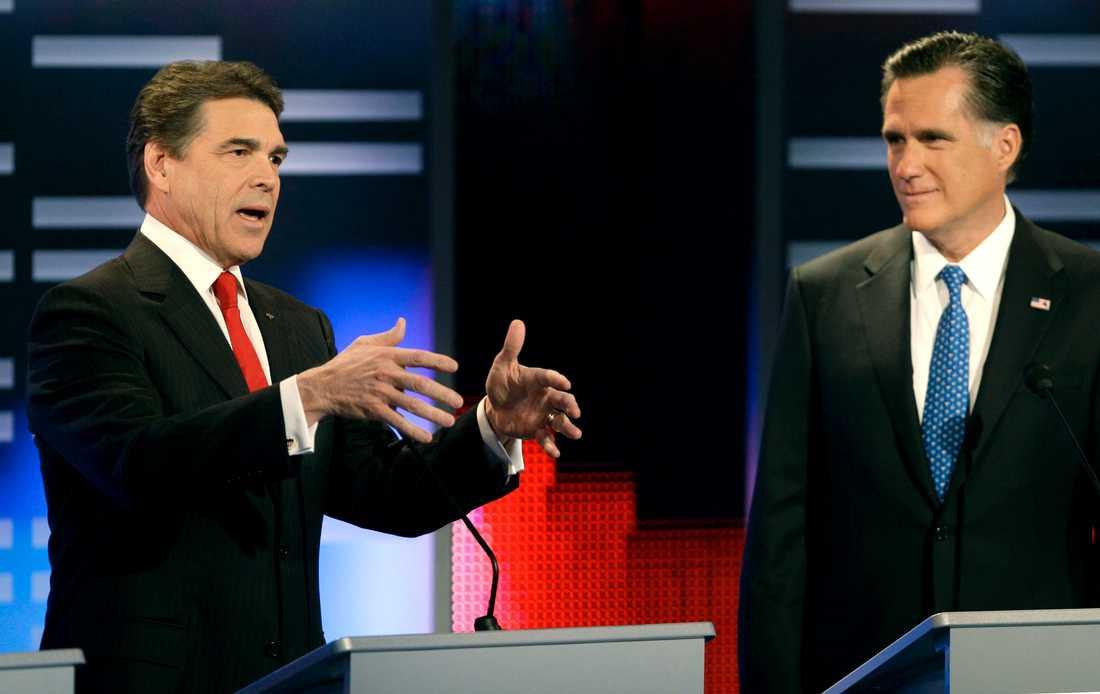Rick Perry och Mitt Romney.