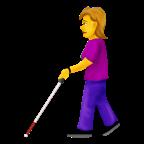 Kvinna med synnedsättning med hjälpmedel.