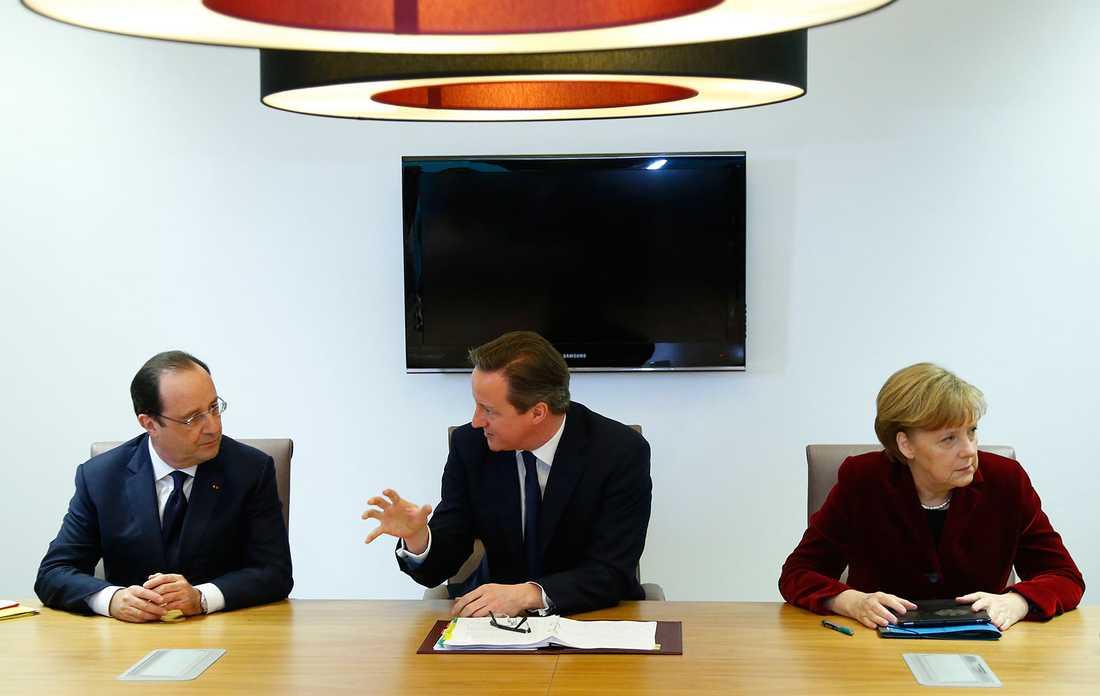 EU-ledarna Hollande, Cameron och Merkel.