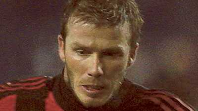 David Beckham trivs i Milantröjan.