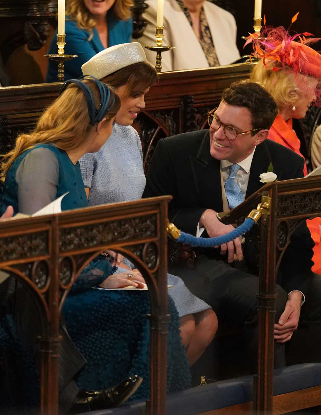 Princess Beatrice of York (L) Britain's Princess Eugenie of York (C) and Jack Brooksbank