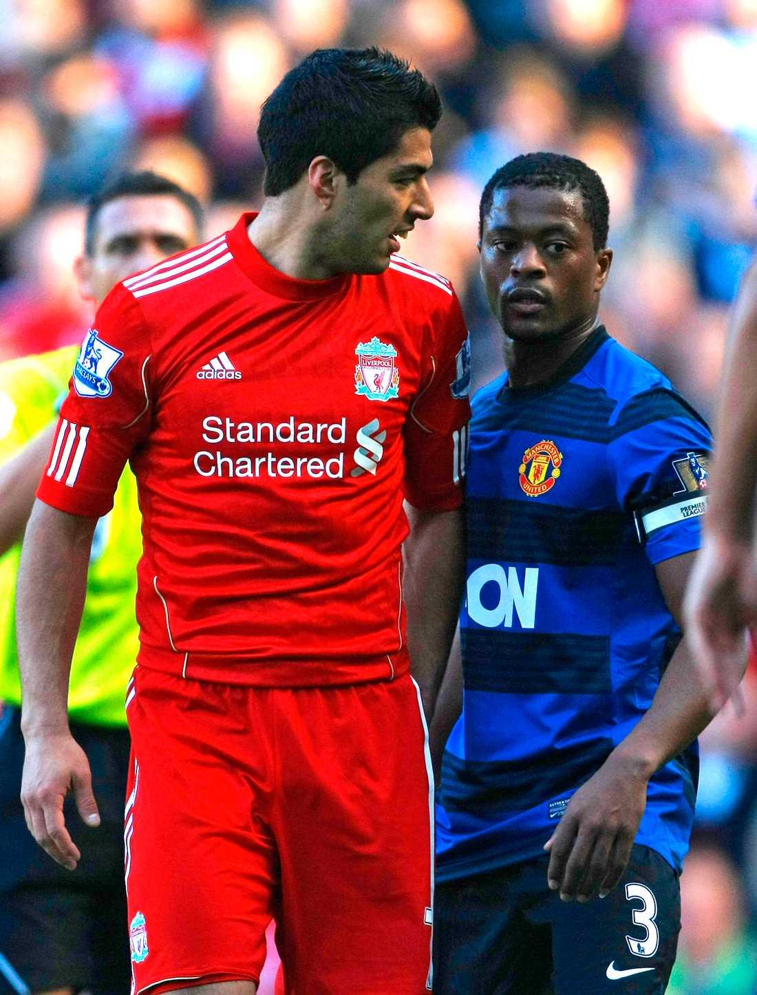 Luis Suarez och Patrice Evra.
