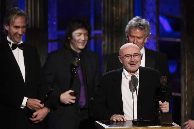 Rock and Roll Hall of Fame inductees from Genesis Phil Collins speaks in front of Mike Rutherford (L), Tony Banks (R) and Steve Hackett during the 25th annual Rock and Roll Hall of Fame induction ceremony at the Waldorf Astoria Hotel in New York, March 15, 2010. REUTERS/Lucas Jackson (UNITED STATES - Tags: ENTERTAINMENT)
