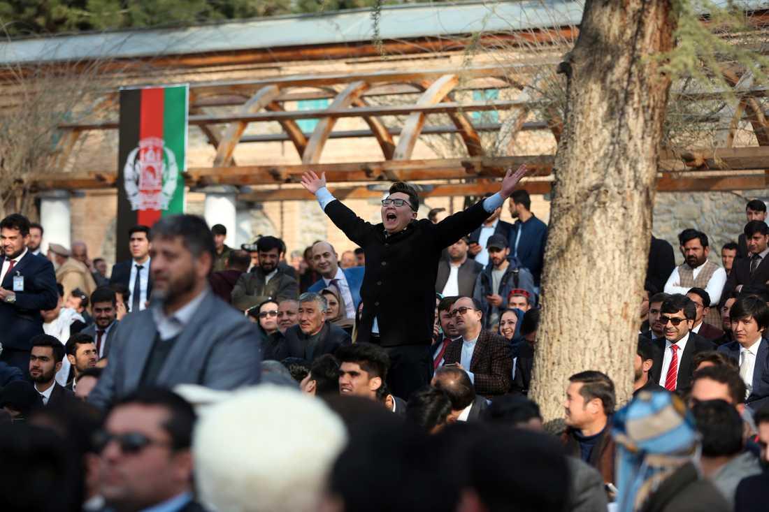 Anhängare till Afghanistans president Ashraf Ghani,vid måndagens installationsceremoni i Kabul.