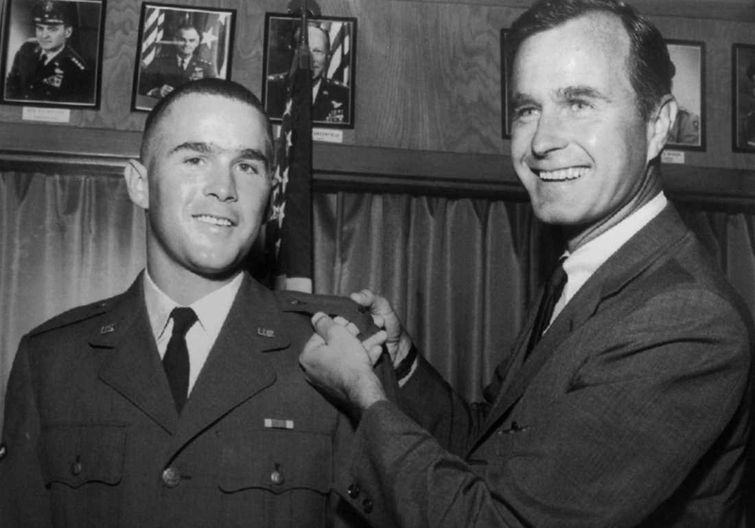 n this 1968 file photo provided by the Texas National Guard, George H.W. Bush, right, is about to pin a lieutenant bar on his son, George W. Bush, after the younger Bush was made an officer in the Texas Air National Guard in Ellington Field, Texas. Bush died at the age of 94 on Friday, Nov. 30, 2018, about eight months after the death of his wife, Barbara Bush.