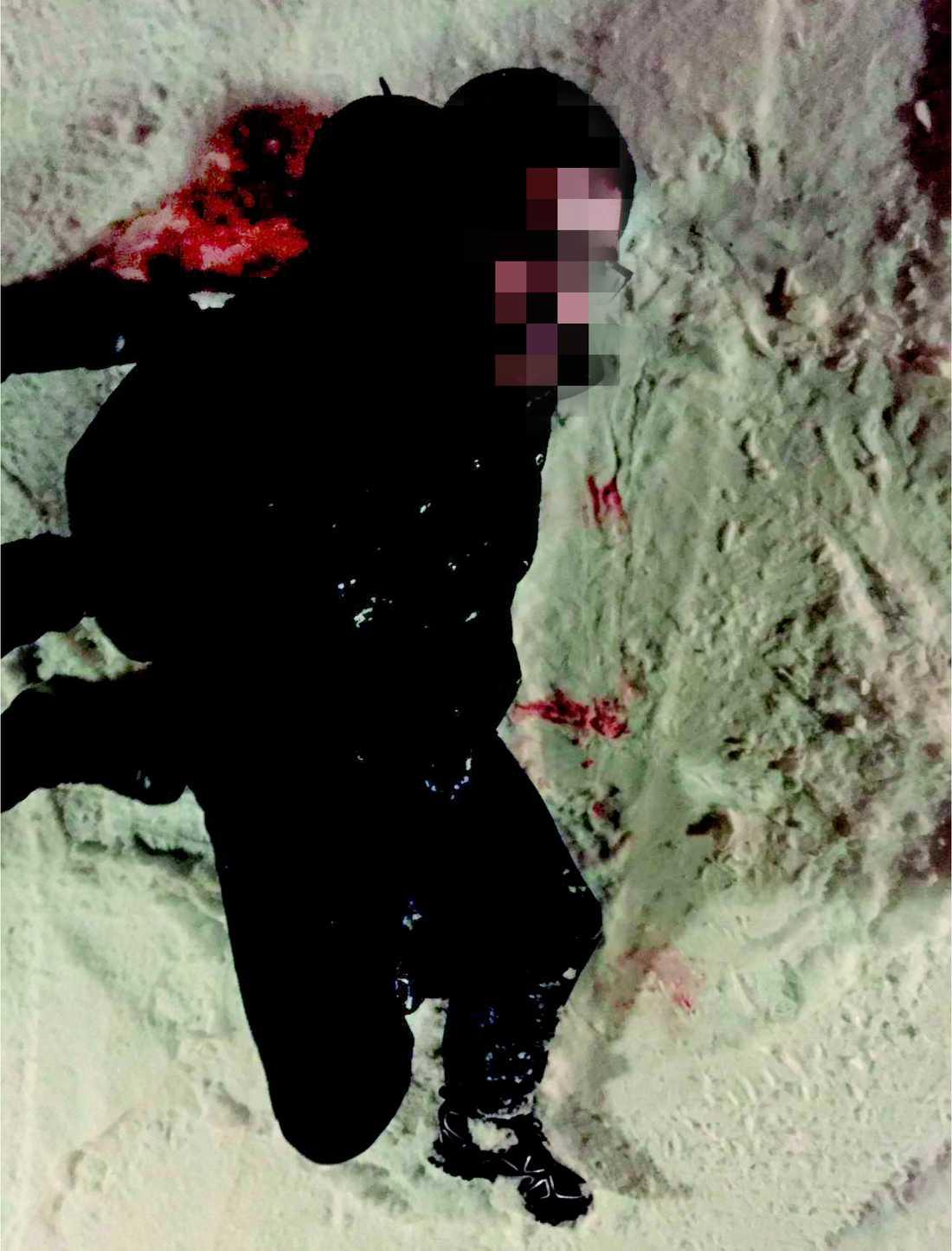 Mördaren efter polisens gripande.