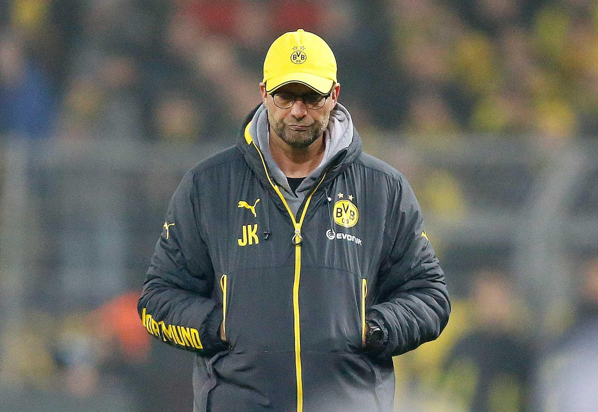 Inga glada miner. Men Jürgen Klopp får behålla jobbet i Dortmund, enligt oddsen.