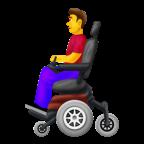 Man i elektrisk rullstol.