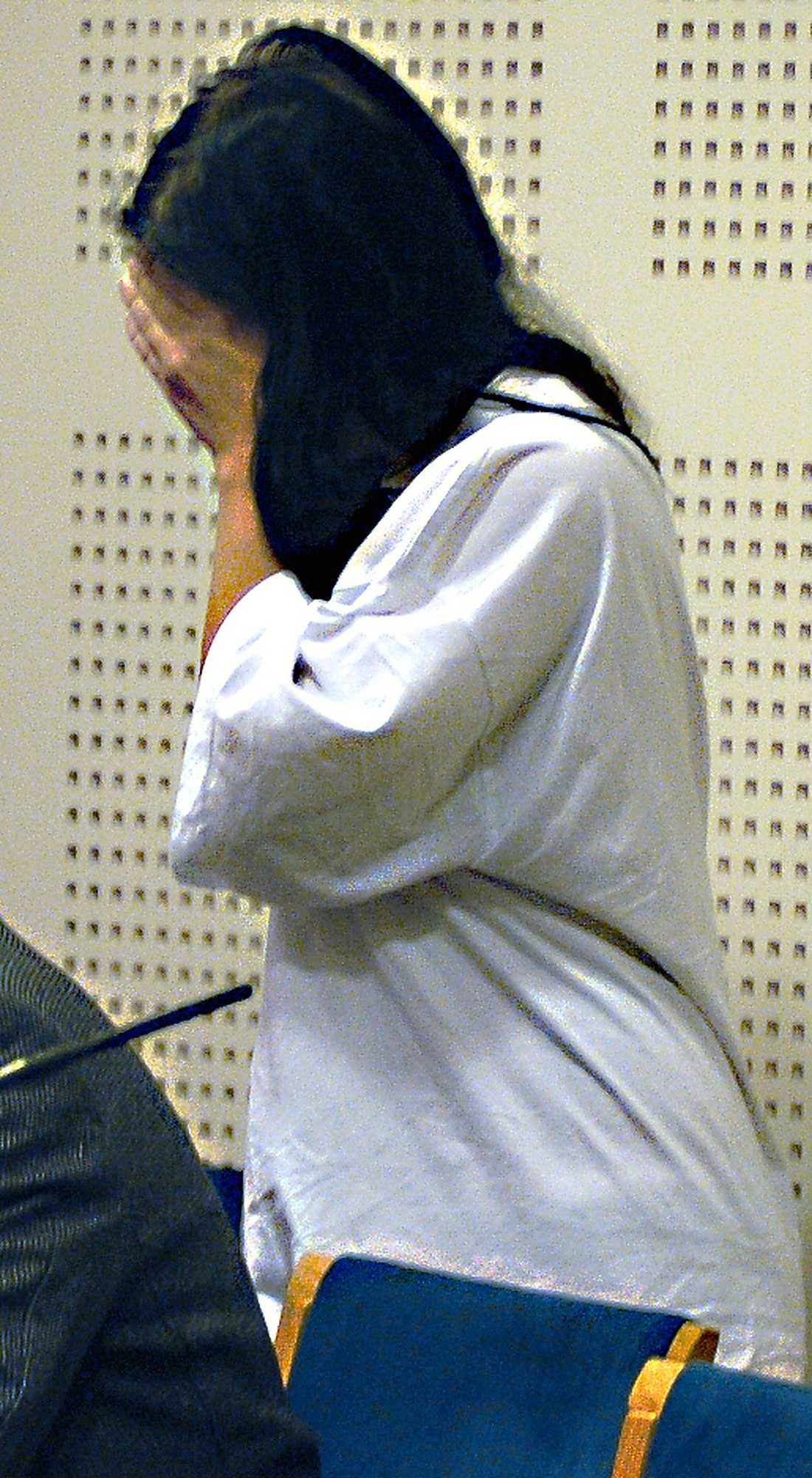 ÅTALAD Den 20-åriga kvinnan åtalas för mord alternativt medhjälp till mord.