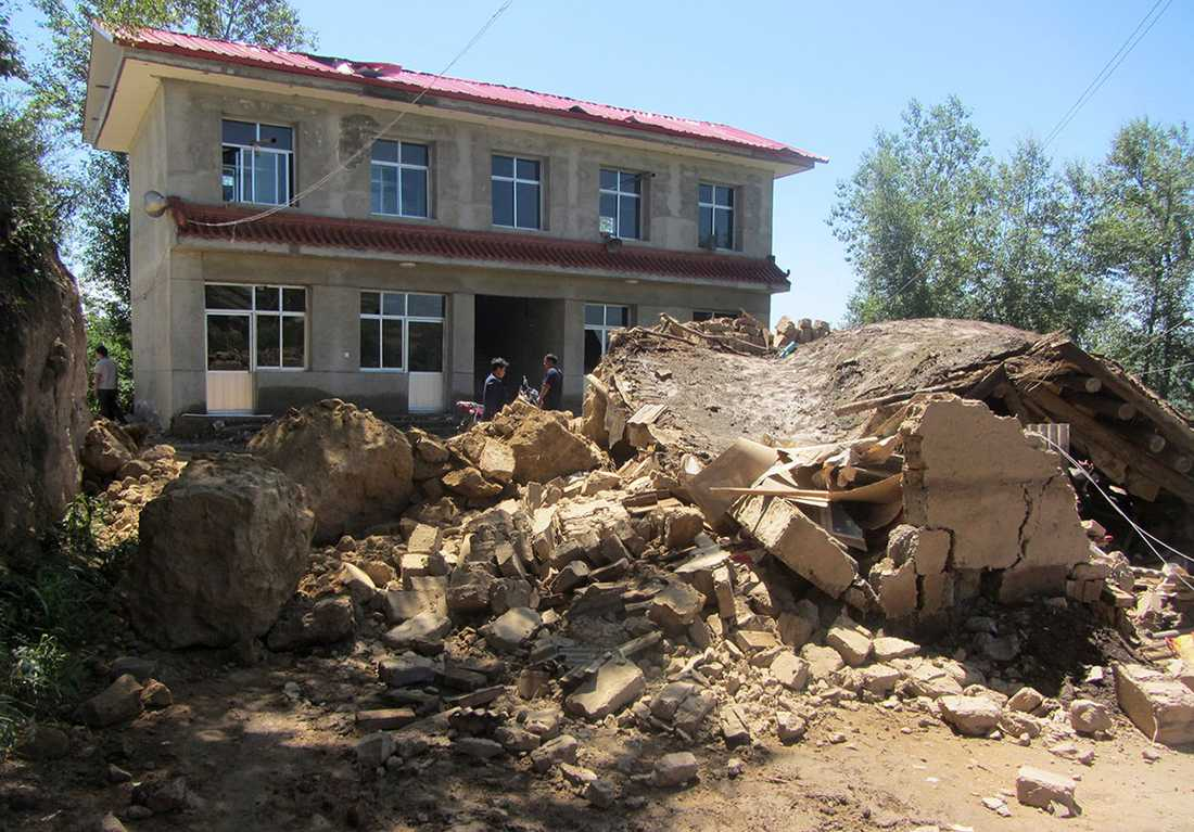 Ett raserat hus i Minxian.