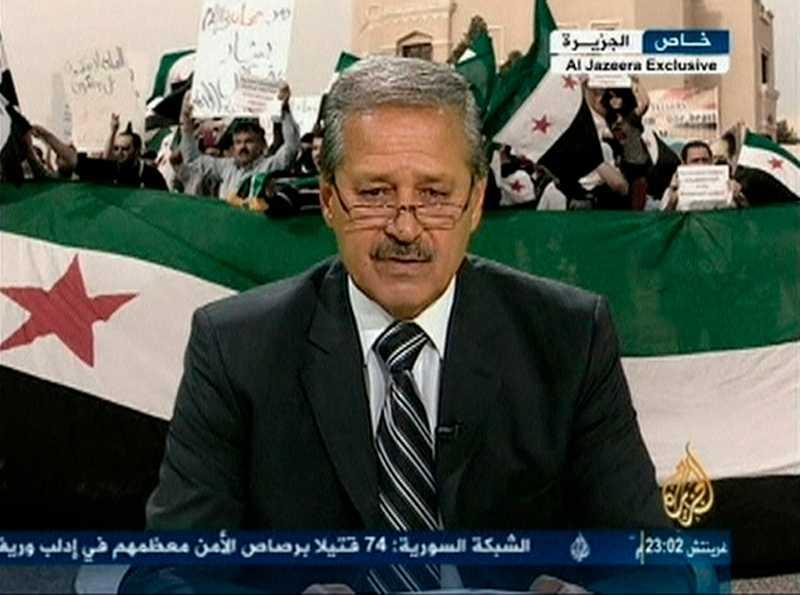 Syriens ambassadör i Irak Nawah al-Fares.
