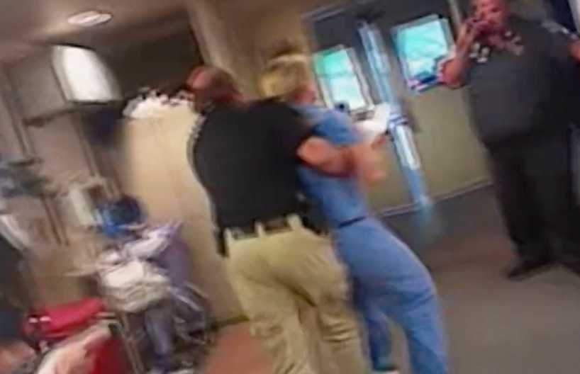 Här förs Alex Wubbels bort av polisen.