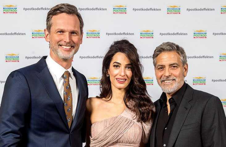 Rickard Sjöberg med Amal och George Clooney.