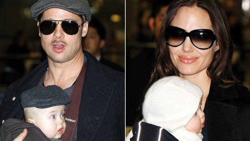 Brad Pitt anlände till Japan med lille sonen Knox i en sele på magen. Angelina Jolie kom steget efter och bar på tvillingsyrran Vivienne.