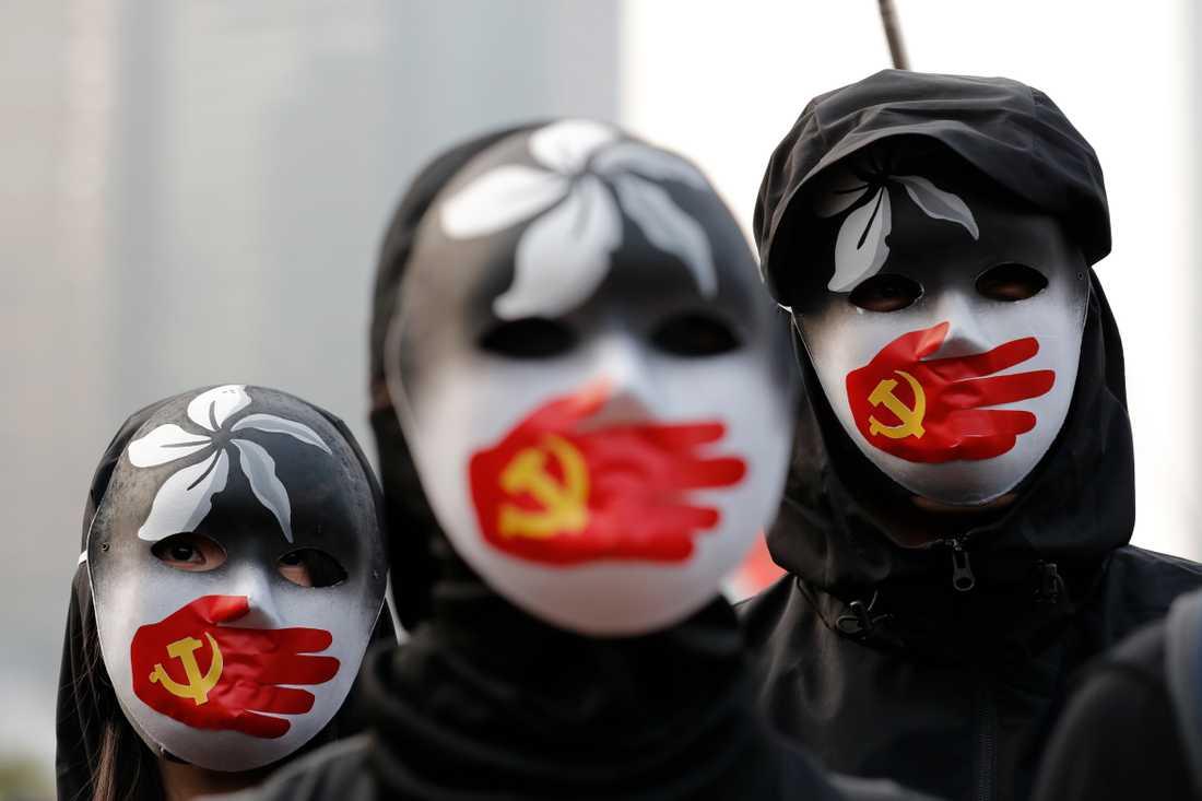 Protester i Hongkong mot hur Peking behandlar uigurer i Kina. Arkivbild