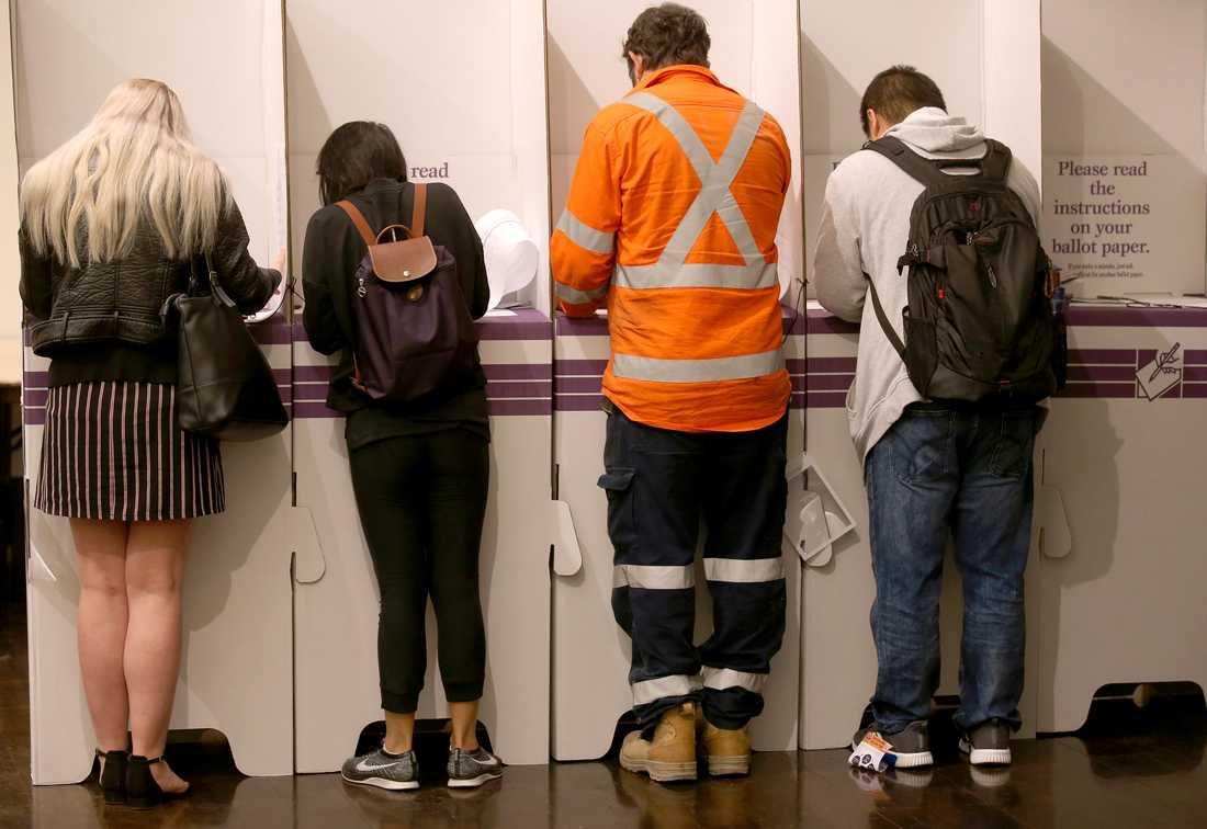 Australier som röstar i parlamentsvalet som hölls den 18 maj i år. Arkivbild.