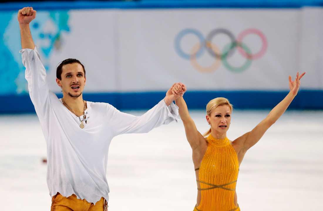 Tatiana Volosozhar med landsmannen Maxim Trankov under hemma-OS 2014.