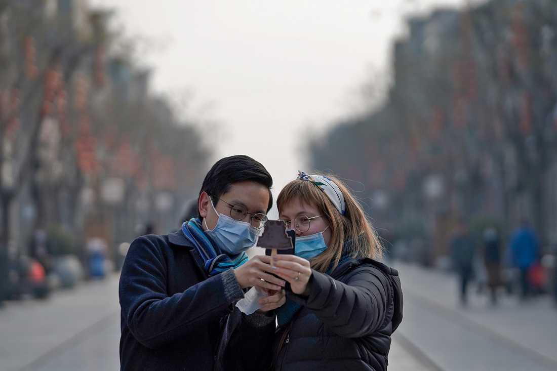 Turister tar en selfie i Kinas huvudstad Peking.