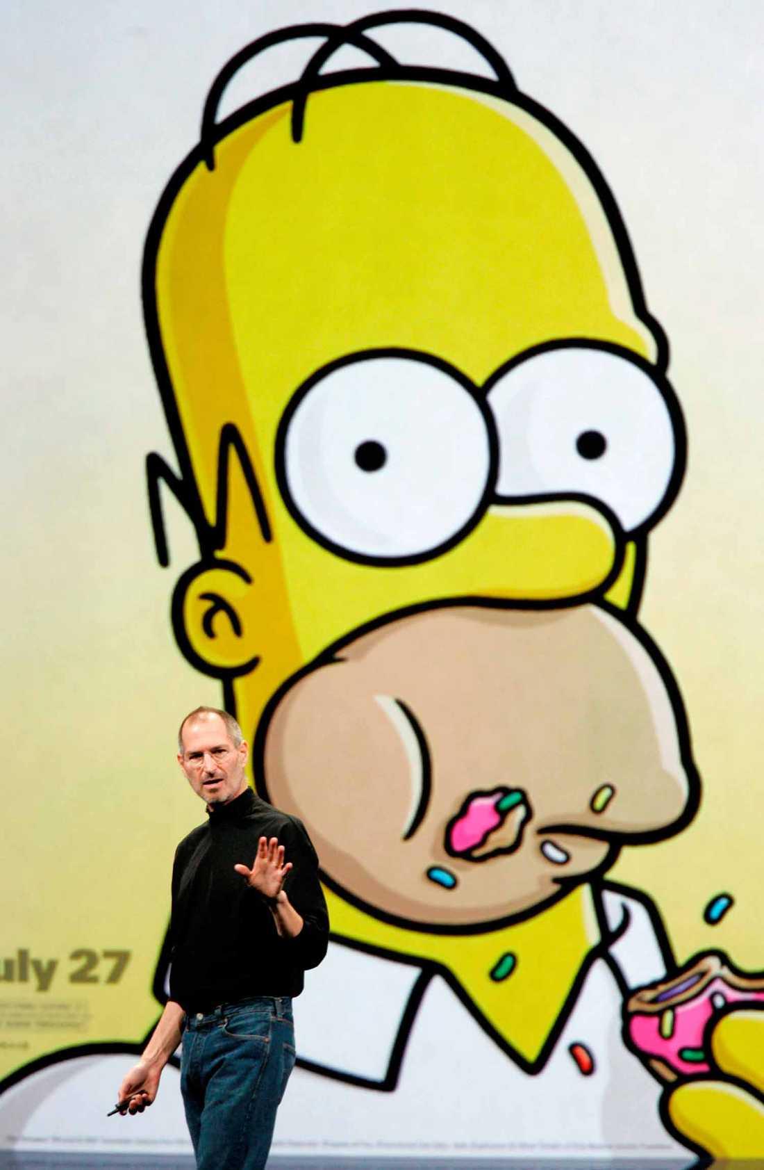 Giganter 2 Steve Jobs presenterar uthyrning av filmer i Itunes på MacWorld i San Francisco 2008. Homer Simpson illustrerar.
