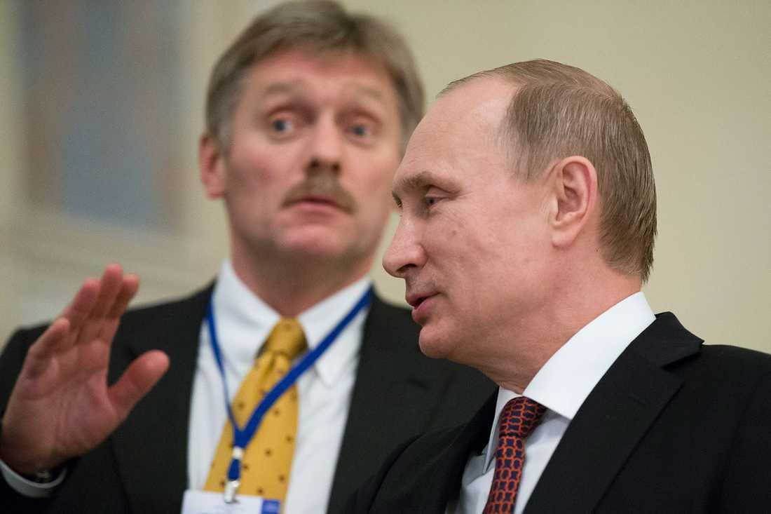 Vladimir Putin och hans talesperson Dmitrij Peskov.