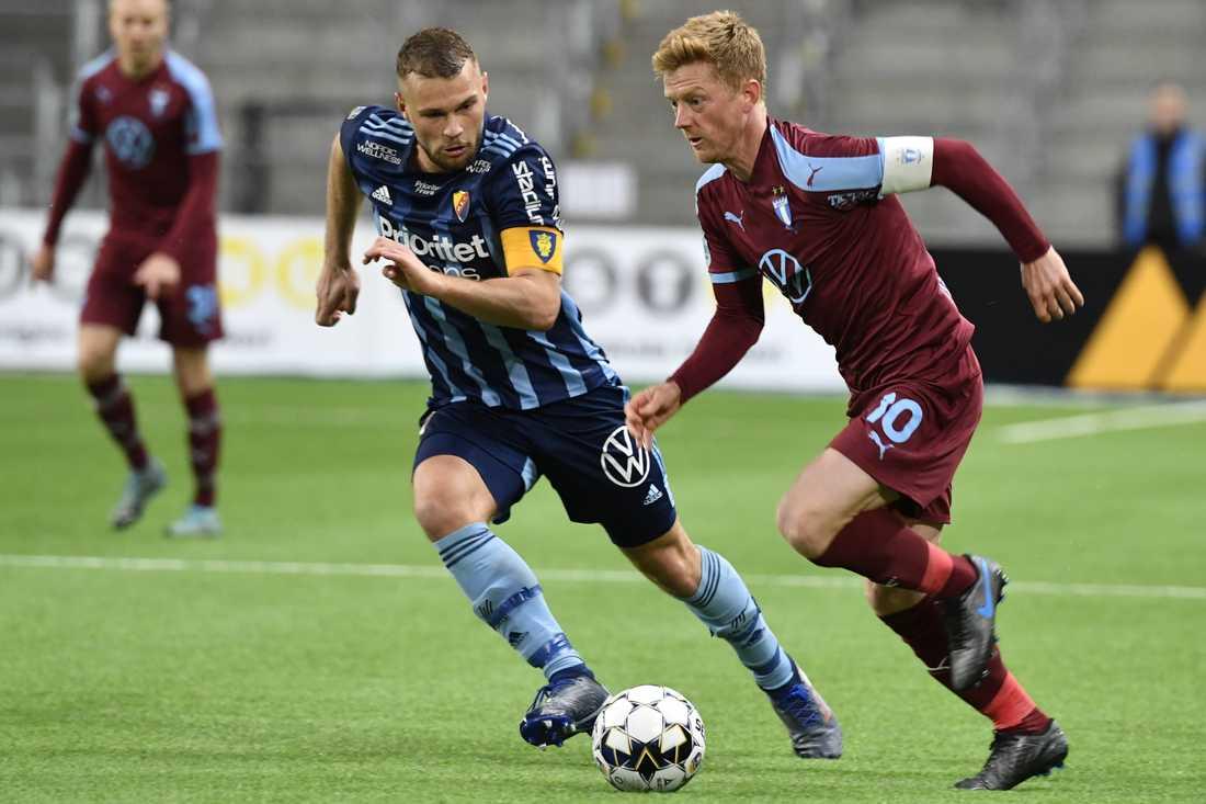 Djurgårdens Jesper Karlström mot Malmö FF:s Anders Christiansen.
