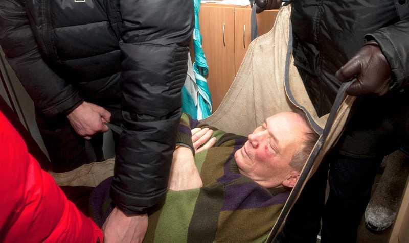 Oppositionsledaren Vladimir Nekljajev efter att han slagits medvetslös av polis i Minsk.