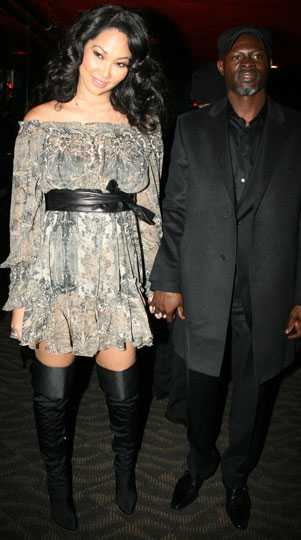 Kimora Lee Simmons, som står bakom Baby Phat, tillsammans med sin pojkvän Djimon Hounsou.
