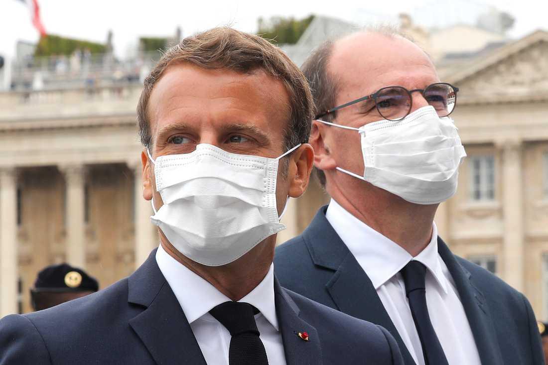 Frankrikes president Emmanuel Macron och premiärminister Jean Castex i munskydd under det franska nationaldagsfirandet tidigare i veckan.